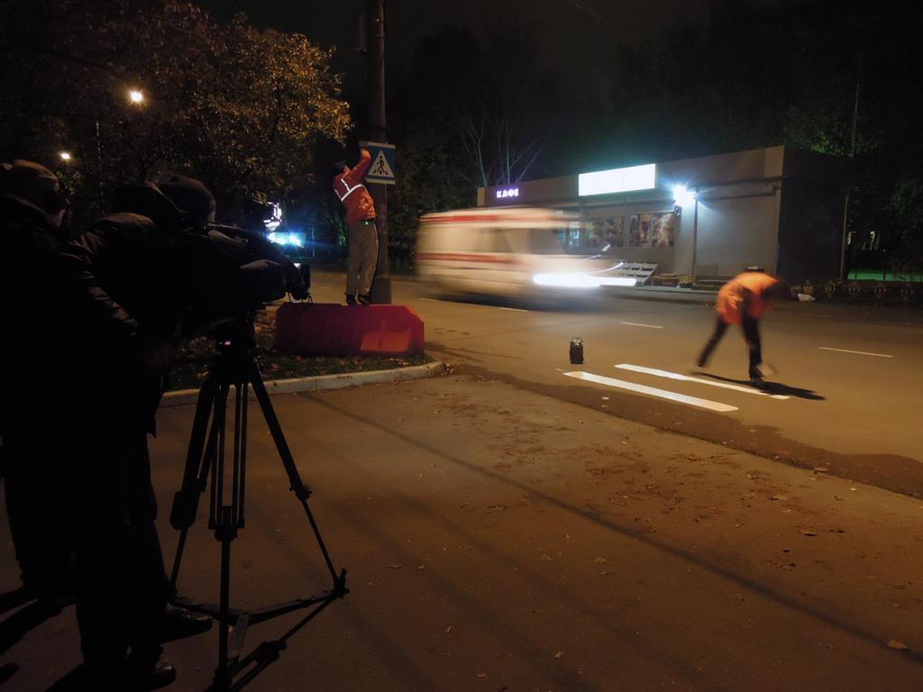 Partizaning install an unauthorised zebra crossing near Kievskaya metro station.
