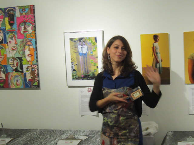 Director Alexis Zimberg explaining the meaning of her piece to friends and potential buyers.